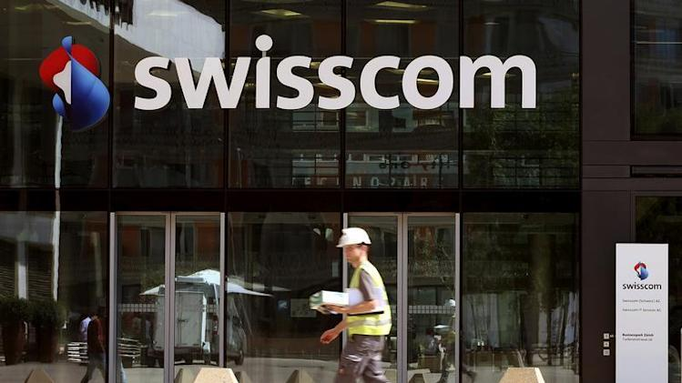 The logo of Swiss telecom company Swisscom AG is seen at an office building in Zurich