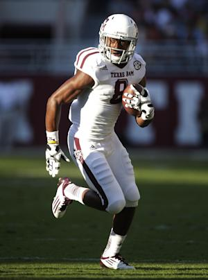 FILE - In this Nov. 10, 2012, file photo, Texas A&M wide receiver Thomas Johnson (8) carries for extra yardage after a reception during the first half of an NCAA college football game against Alabama in Tuscaloosa, Ala. Johnson has been found safe in Dallas after he disappeared from campus days ago. Johnson's mother, Linda Hanks, says A&M University police told her Thursday, Nov. 15, 2012, the 18-year-old is unharmed. (AP Photo/Dave Martin, File)