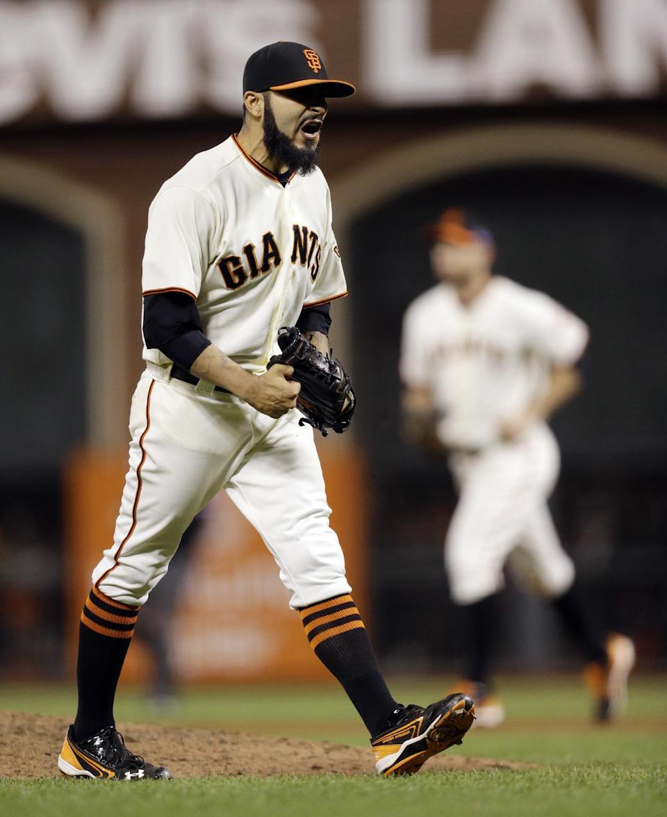 San Francisco Giants relief pitcher Sergio Romo reacts after the final out in the ninth inning of Game 6 of baseball's National League championship series against the St. Louis Cardinals Sunday, Oct. 21, 2012, in San Francisco. The Giants won 6-1 to tie the series at 3-3. (AP Photo/Ben Margot)