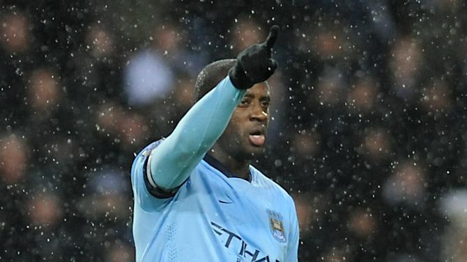 Manchester City's Yaya Toure reacts to supporters after scoring against West Brom during the English Premier League soccer match between West Bromwich Albion and Manchester City at the Hawthorns, Birmingham, England, Friday, Dec. 26, 2014. (AP Photo/Rui Vieira)