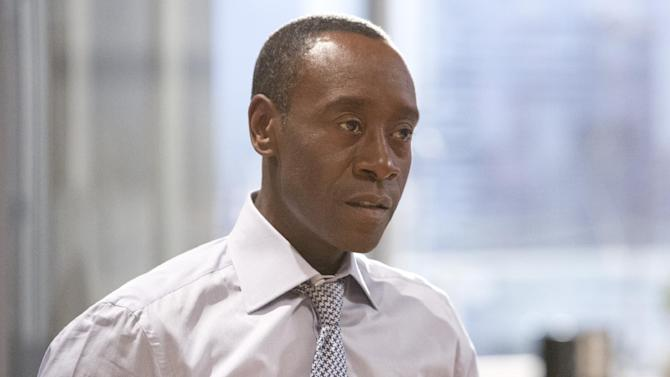 "This publicity image released by Showtime shows Don Cheadle in ""House of Lies."" Cheadle is nominated for an Emmy Award for best actor in a comedy series for his role as Marty Kaan. The Academy of Television Arts & Sciences' Emmy ceremony will be hosted by Neil Patrick Harris. It will air Sept. 22 on CBS. (AP Photo/Showtime, Michael Desmond)"
