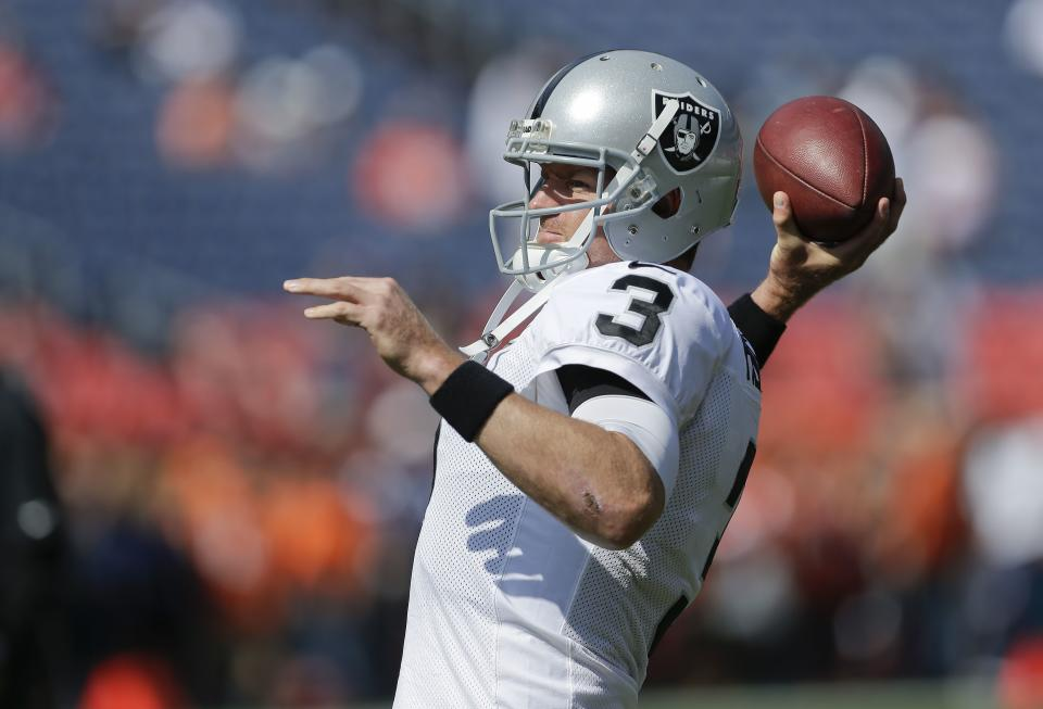 Oakland Raiders quarterback Carson Palmer (3) warms up before the start of an NFL football game against the Denver Broncos, Sunday, Sept. 30, 2012, in Denver. (AP Photo/Joe Mahoney)
