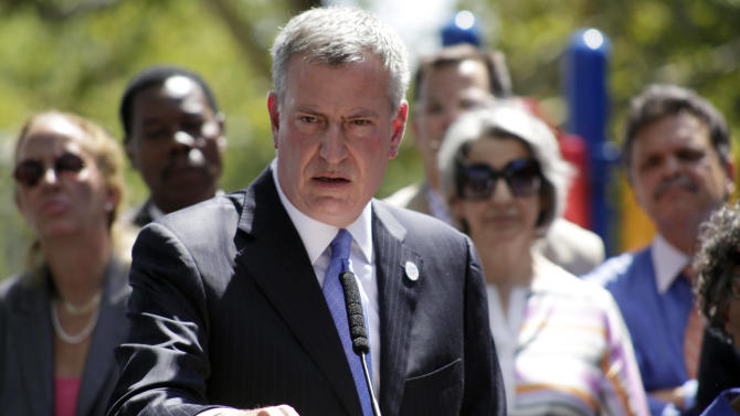 File-This Aug. 28, 2014, file photo shows New York City Mayor Bill de Blasio speaking during a press conference in the Brooklyn borough of the city of New York. Mayor Bill de Blasio is winding down his first year in office, which saw success at fulfilling many of his liberal campaign promises. But the year ends with his young mayoralty facing its biggest crisis yet: an open rebellion from police officers who don't believe the mayor supports them.  (AP Photo/Vanessa A. Alvarez, File)