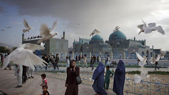IMAGE DISTRIBUTED ON BEHALF OF THE SONY WORLD PHOTOGRAPHY AWARDS - Families visit the shrine of Hazrat Ali, or the Blue Mosque, in Mazar-i-Sharif in Afghanistan on May 11, 2012. The historical mosque attracts thousands of pilgrims each year. This photo by has been shortlisted for a Sony World Photography Award. The winners of the Sony World Photography Awards will be announced on April 25, 2013. (Kuni Takahashi/Sony World Photography Awards via AP Images)