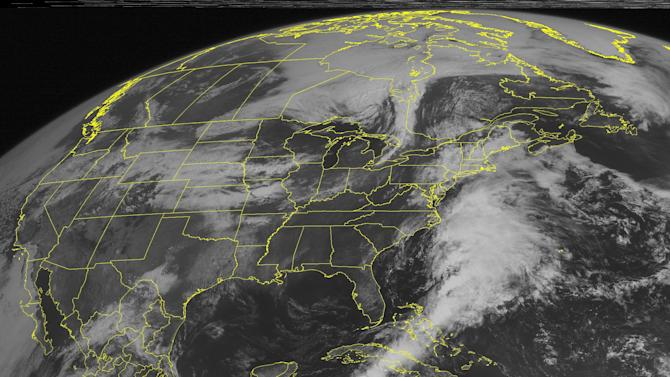 This NOAA satellite image taken Friday, May 25, 2012 at 10:45 AM EDT shows clouds cover the Central Plains and move into the Midwest as a low pressure system moves off the Rockies and into the Plains.  This pushes a warm front eastward, which kicks up more scattered showers and thunderstorms across the Central US. Some of these storms will turn severe with strong winds and large hail.  (AP PHOTO/WEATHER UNDERGROUND)