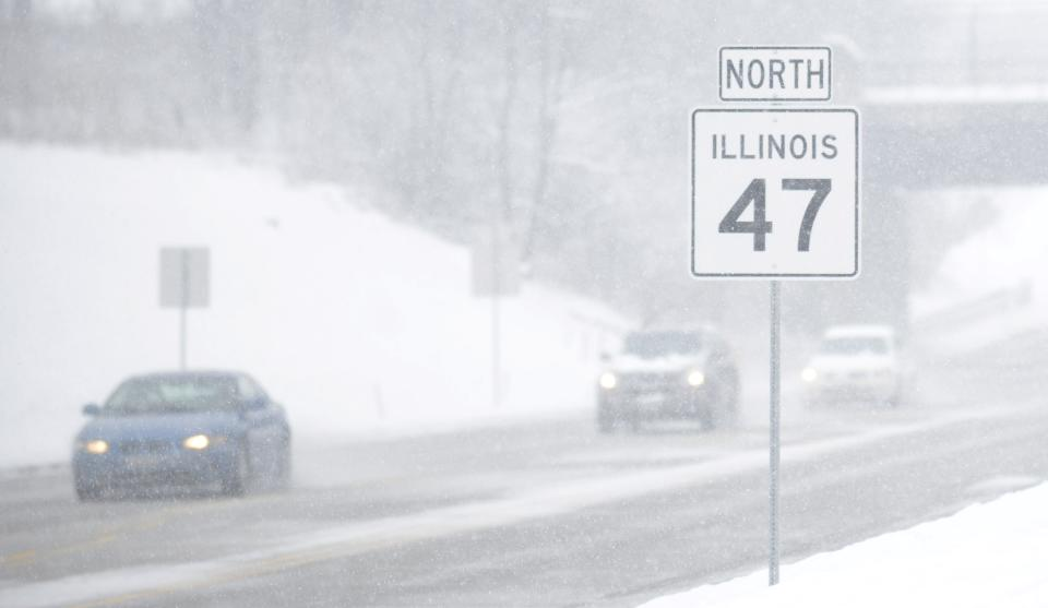 Visibility along Route 47 in the Chicago suburb of Lily Lake, Ill. is very limited as wet snow continues to fall during a snow storm on Tuesday, March 5, 2013. (AP Photo/Daily Herald, Laura Stoecker) MANDATORY CREDIT; MAGS OUT; TV OUT