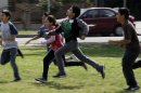 FILE - This May 10, 2011 file photo shows children at Tracy Elementary School running across a field as they take part in after-school exercise activities on the campus in Baldwin Park, Calif. Reading, writing, `rithmetic _ and PE? The prestigious Institute of Medicine is recommending that schools provide opportunities for at least 60 minutes of physical activity each day for students and treat physical education as a core subject. The report says only about half of the nation's youngsters are getting at least an hour of vigorous or moderate physical activity every day. (AP Photo/Reed Saxon, File)