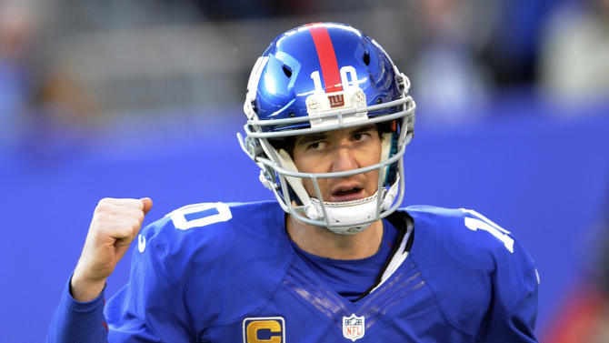New York Giants quarterback Eli Manning (10) reacts after throwing a touchdown pass to Victor Cruz during the first half of an NFL football game against the Philadelphia Eagles, Sunday, Dec. 30, 2012, in East Rutherford, N.J. (AP Photo/Bill Kostroun)