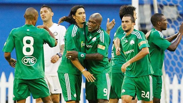 Panathinaikos FC's Djibril Cisse (C) celebrates his goal with teammates Sebastian Leto (2nd L) and Loukas Vyntra (24) against Inter Milan during the first half of their friendly soccer match in Toronto