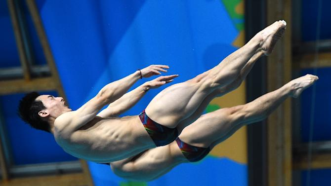 China's divers Cao Yuan and Qin Kay compete in the Men's 3m Springboard Synchronised final diving event at the 2015 FINA World Championships in Kazan on July 28, 2015