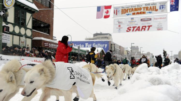 Jim Lanier, of Chugiak, Alaska, leads his team during the ceremonial start of the Iditarod trail sled dog race, Saturday, March 3, 2012, in Anchorage, Alaska. (AP Photo/The Anchorage Daily News, Marc Lester)