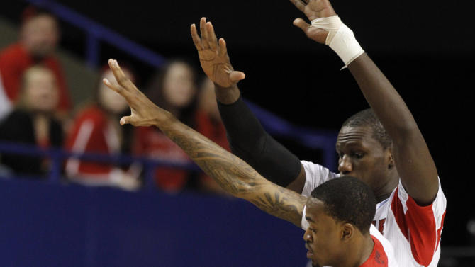 North Carolina A&T guard Lamont Middleton (30) is covered by Louisville guard Kevin Ware (5) and center Gorgui Dieng (10) during the first half of their second-round NCAA college basketball tournament game, Thursday, March 21, 2013, in Lexington, Ky. (AP Photo/James Crisp)