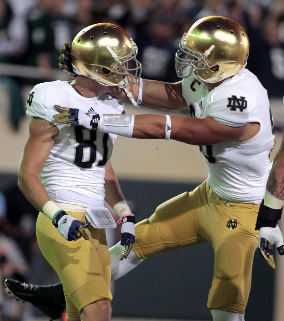 Notre Dame's John Goodman, left, and Tyler Eifert celebrate Goodman's touchdown reception during the first quarter of an NCAA college football game against Michigan State, Saturday, Sept. 15, 2012, in East Lansing, Mich. (AP Photo/Al Goldis)