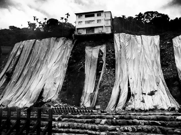 Youth 'Environment' winner: Xu Wei Shou, Taiwan. 'Nature's fightback' shows a house teetering on the edge of a cliff (Xu Wei Shou, Taiwan, Winner, Environment, Youth Competition, 2