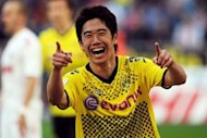 Japan international Shinji Kagawa, pictured in March 2012, is set to become Manchester United&#39;s first summer signing after the Premier League club confirmed Tuesday they have &quot;reached agreement&quot; with his club Borussia Dortmund