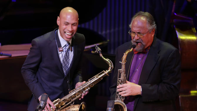 Saxophonists Joshua Redman, left, and Joe Lovano, right, perform during the opening night concert of the SFJAZZ Center Wednesday, Jan. 23, 2013 in San Francisco. The 700-seat, specially designed concert hall nestled in the heart of the city's arts district attracted a crowd of hundreds with a high-energy, inaugural celebration emceed by Bill Cosby. Billed as the first freestanding building in the West built for jazz performance and education, the center opened Wednesday after raising more than $60 million over more than a decade to build a home for SFJAZZ, the nonprofit that puts on the city's jazz festival. (AP Photo/Eric Risberg)