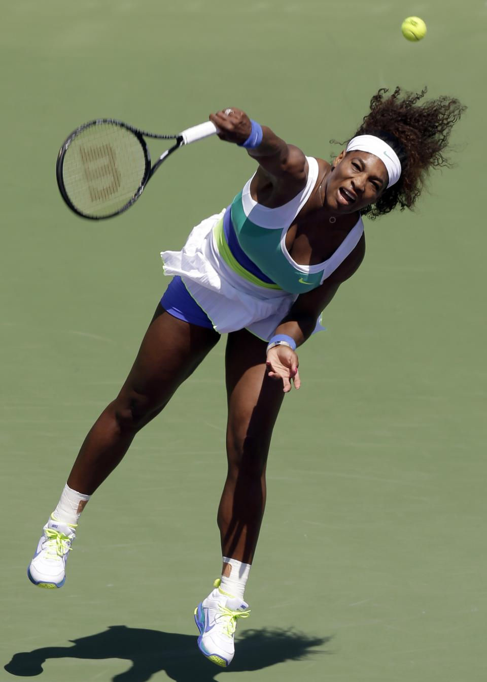 Serena Williams serves to Maria Sharapova, of Russia, during the final match of the Sony Open tennis tournament, Saturday, March 30, 2013, in Key Biscayne, Fla. (AP Photo/Wilfredo Lee)