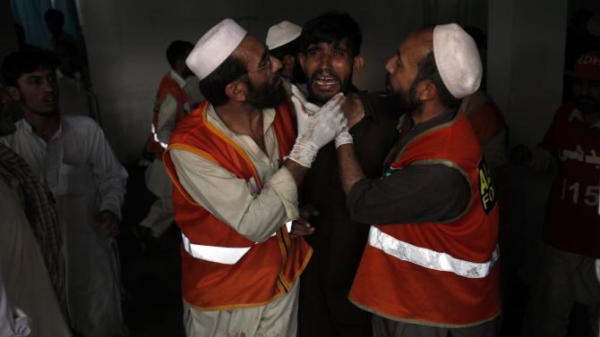 Man cries over the death of his brother, who was killed in a bomb blast, at a hospital in Peshawar