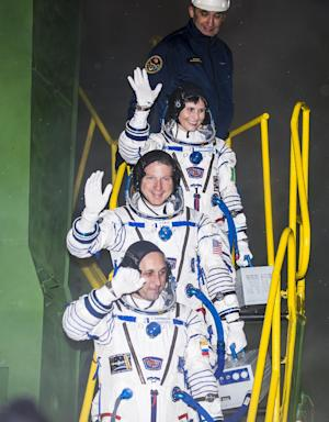 (From top) Expedition 42 Flight Engineer Samantha Cristoforetti,…