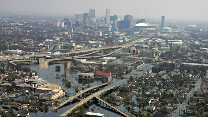 FILE - In this Saturday, Sept. 10, 2005 file photo, nearly two weeks since Hurricane Katrina hit, floodwaters continue to cover parts of New Orleans. Humans have an affinity for water. But in these recent jumbled days, the collapsed houses, flooded subway tunnels and washed-out roads left in Sandy's wake remind us once again: Our deep-seated human desire to be near the water _ to be attracted and comforted by it, to build alongside it and crave its attractions _ has an undeniable dark side. (AP Photo/David J. Phillip, Pool, File)