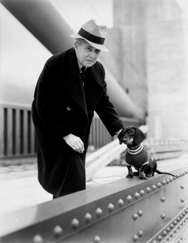 Joseph Strauss with a dog. From the holdings of the Golden Gate Bridge, Highway and Transportation District, Used with Permission, www.goldengate.org