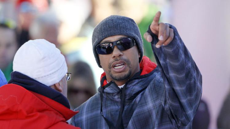 Golfer Tiger Woods of the U.S. watches the Women's World Cup Downhill skiing race in Val d'Isere