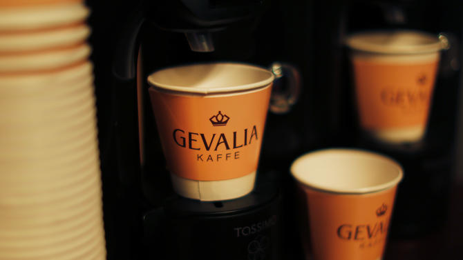 Coffee cups rest on a counter as free Gevalia coffee samples are offered to New Yorkers and visitors at a temporary Gevalia cafe open from Dec. 26-31 at 253 West 47th Street, on Dec. 27, 2012, in New York. (John Minchillo /AP Images for Gevalia)