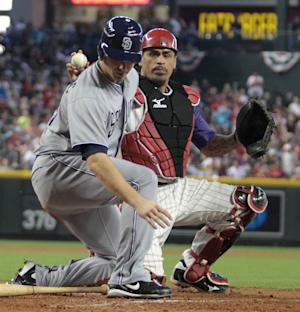 Arizona Diamondbacks' catcher Henry Blanco show the ball to the umpire after tagging out San Diego Padre's Wade LeBlanc in the third inning of a baseball game Sunday, Sept. 11, 2011, in Phoenix.(AP Photo/Darryl Webb)