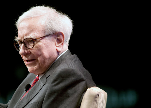 FILE - In this Tuesday, June 5, 2012, file photo, Warren Buffett, chairman and CEO, of Berkshire Hathaway, Inc., speaks during the Economic Club of Washington&#39;s 25th anniversary celebration dinner in Washington. Billionaire investor Warren Buffett said Wednesday, Oct. 24, 2012, that the global economy is definitely slowing because of continued problems in Europe and the decline in Asia, but the U.S. economy is still improving modestly and business will improve regardless of who wins the presidential election. (AP Photo/Cliff Owen, File)