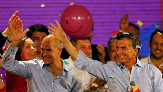 Macri, Buenos Aires' City Mayor and presidential candidate for PRO party, talks to celebrates with mayoral race elected candidate Horacio Rodriguez Larreta after the election in Buenos Aires