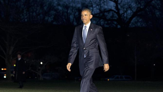 President Barack Obama walks across the South Lawn to the White House as he arrives on Marine One, Thursday, March 26, 2015, in Washington, as he returns from Birmingham, Ala., where he spoke about the economy. (AP Photo/Carolyn Kaster)