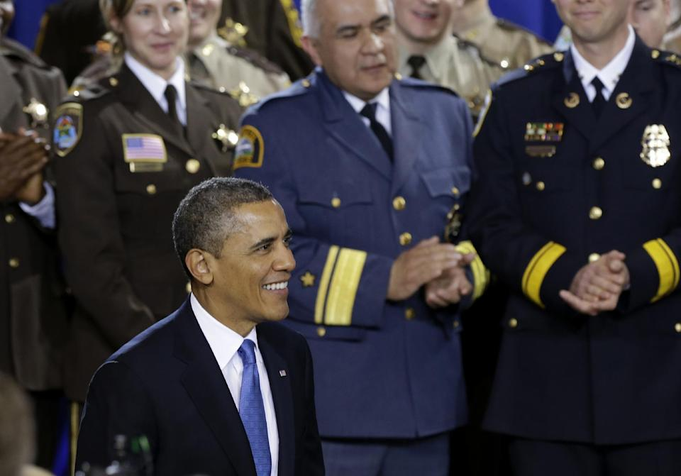 President Barack Obama is applauded prior to speaking about his gun violence proposals, Monday, Feb. 4, 2013, at the Minneapolis Police Department's Special Operations Center in Minneapolis, where he outlined his plan before law enforcement personnel.  (AP Photo/Jim Mone)