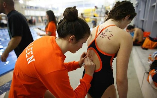 Eastside Catholic High swimmers pledge their support to recently fired coach Mark Zmuda -- Associated Press