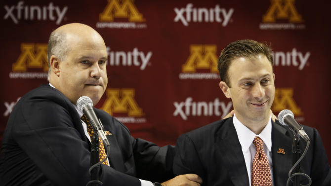 Minnesota athletic director Norwood Teague, left, introduces Richard Pitino as the new men's basketball coach at a news conference, Friday, April 5, 2013, in Minneapolis. (AP Photo/The Star Tribune, Brian Peterson)  MANDATORY CREDIT; ST. PAUL PIONEER PRESS OUT; MAGS OUT; TWIN CITIES TV OUT