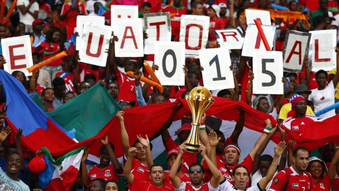 Fans of Equatorial Guinea cheer before their Group A soccer match against Gabon at the African Cup of Nations in Bata