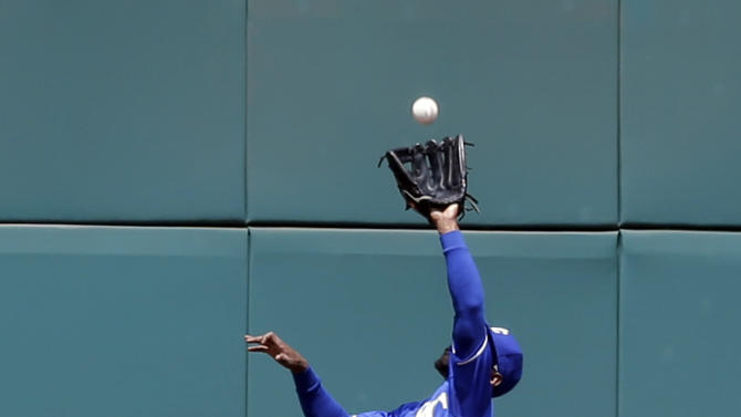 Kansas City Royals' Jarrod Dyson jumps for a ball hit by Cleveland Indians' Jason Kipnis in the fourth inning of a baseball game, Wednesday, July 29, 2015, in Cleveland. Kipnis was out on the play. (AP Photo/Tony Dejak)