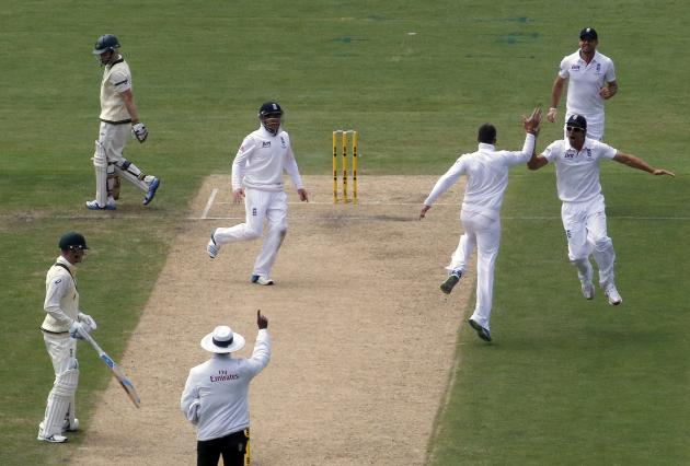 England's captain Cook celebrates after dismissing Australia's Rogers during the first day's play in the second Ashes test in Adelaide
