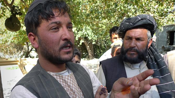 """In this Thursday, Nov. 15, 2012 photo, construction worker Abdul Razziq speaks during an interview in Kajaki, Helmand province, south of Kabul, Afghanistan. The number of workers on a U.S.-funded construction project next to Kajaki has dwindled from 200 to 20 since last fall, and those remaining say workers feel the risk isn't worth the $6 daily paycheck. """"They can't come here because all the routes to the district are controlled by the Taliban,"""" said Razziq, a 28-year-old villager working on construction of a new district government center next to the dam. (AP Photo/Heidi Vogt)"""