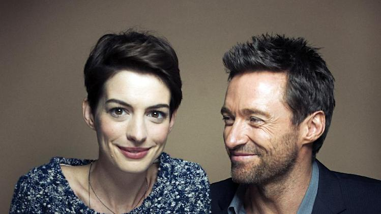 "This Dec. 2, 2012 photo shows actors Anne Hathaway, left, and Hugh Jackman in New York. Hathaway portrays Fantine and Jackman portrays Jean Valjean in the film adaptation of the Victor Hugo novel, ""Les Miserables."" The film opens on Christmas Day. (Photo by Victoria Will/Invision/AP)"
