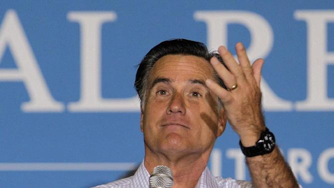 Republican presidential candidate, former Massachusetts Gov. Mitt Romney reacts to hecklers while speaking at a campaign rally, Wednesday, Sept. 26, 2012, in Westerville, Ohio. (AP Photo/Jay LaPrete)