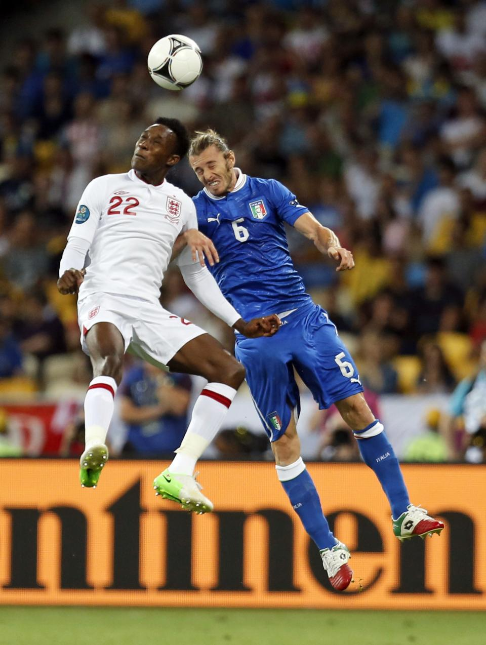 England's Danny Welbeck, left, and Italy's Federico Balzaretti jump for the ball during the Euro 2012 soccer championship quarterfinal match between England and Italy in Kiev, Ukraine, Sunday, June 24, 2012. (AP Photo/Matthias Schrader)