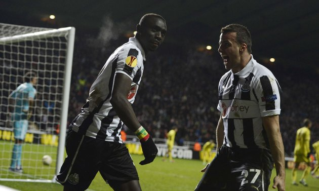 Newcastle United's Cisse celebrates scoring with Taylor against Anzhi Makhachkala during their Europa League soccer match in Newcastle