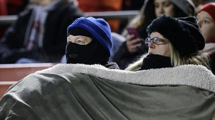 Fans are bundled against the cold as they watch Rutgers play South Florida in an NCAA college football game in Piscataway, N.J., Saturday, Dec. 7, 2013. Rutgers won 31-6. (AP Photo/Mel Evans)