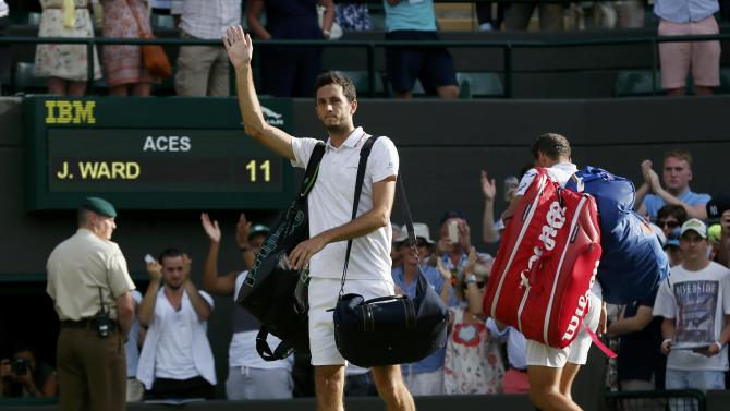 James Ward of Britain waves to fans after losing his match against Vasek Pospisil of Canada at the Wimbledon Tennis Championships in London