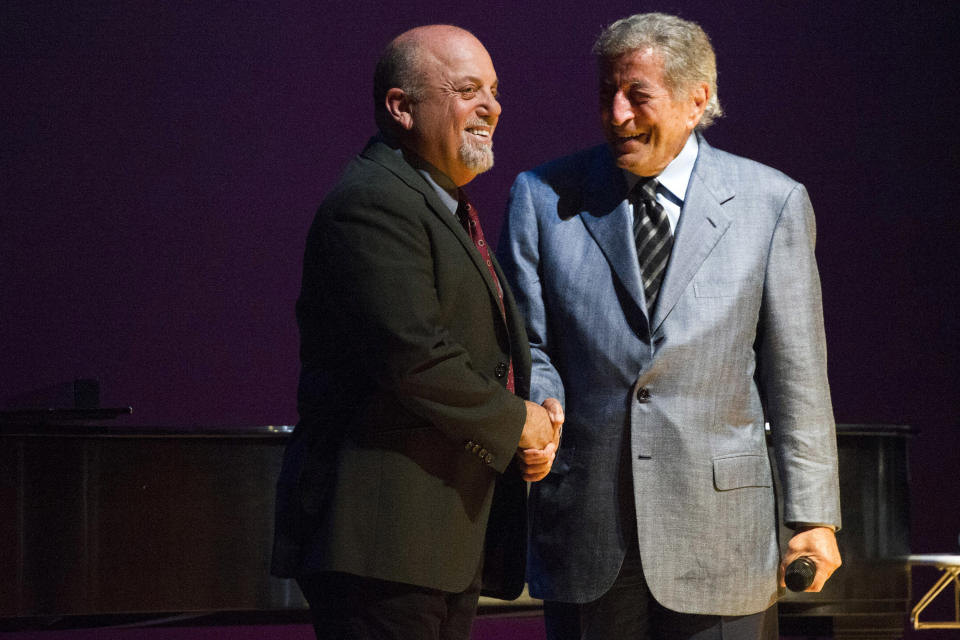 Tony Bennett, right, introduces speaker Billy Joel at a special master class school-wide assembly event for the Frank Sinatra School of the Arts, the public high school Bennett founded, on Thursday, May 30, 2013 in New York. (Photo by Charles Sykes/Invision/AP)