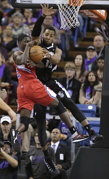 Sacramento Kings forward Derrick Williams, right, blocks the drive of Los Angeles Clippers guard Darren Collison during the fourth quarter of an NBA basketball game in Sacramento, Calif., Friday, Nov.