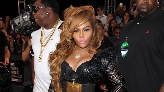 FILE - This Aug. 25, 2013 file photo shows Lil' Kim at the MTV Video Music Awards in the Brooklyn borough of New York. Lil Kim has a lil one of her own: The rapper is now a mother. Lil Kim's assistant, Noel Perez, confirmed that the 38-year-old gave birth to daughter Royal Reign on Monday, June 9, 2014. (Photo by John Shearer/Invision/AP, File)