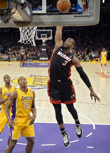 LeBron's Heat hold off Kobe's Lakers 99-90