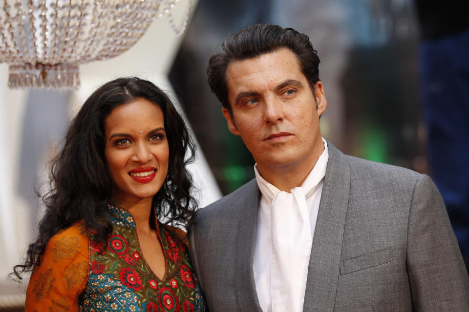 British film director Joe Wright and his wife sitarist Anoushka Shankar pose as they arrive for the world premiere of Anna Karenina in London, Tuesday, Sept. 4, 2012. (AP Photo/Sang Tan)