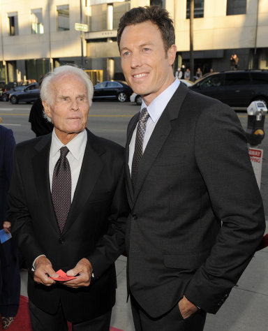 "In this July 27, 2010 file photo, Dean Zanuck, right, producer of the film ""Get Low,"" poses with his father, veteran film producer Richard Zanuck, at the premiere of the film in Beverly Hills, Calif. According to his publicist, producer Richard D. Zanuck has died at age 77 on Friday, July 13, 2012, in Los Angeles. Zanuck won an Oscar for best picture for his film, ""Driving Miss Daisy."" (AP Photo/Chris Pizzello, File)"